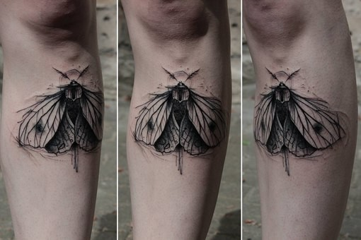 Sketch style black ink leg tattoo of small butterfly