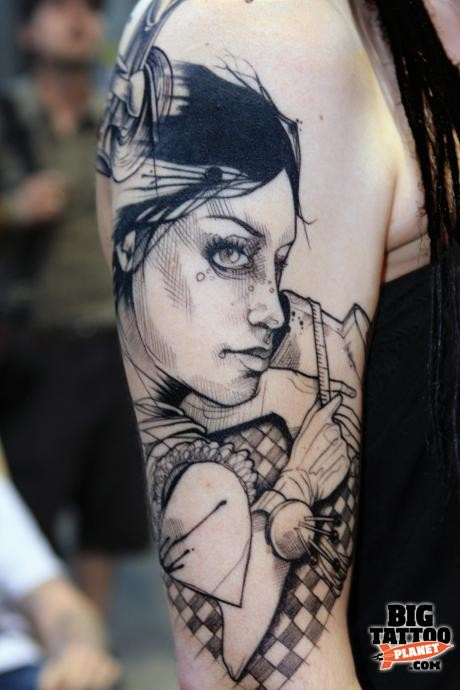 Sketch style black ink shoulder tattoo of woman with needles