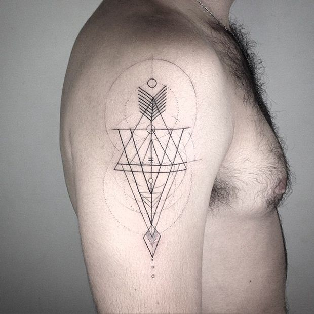 Sketch style black ink shoulder tattoo of geometrical ornaments