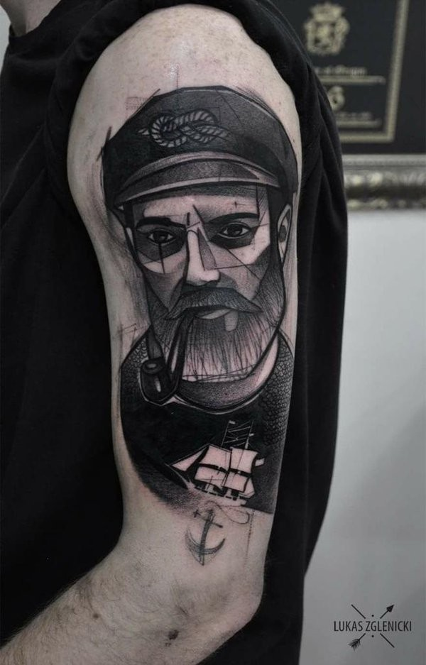 Sketch style black ink shoulder tattoo of smoking sailor with beard