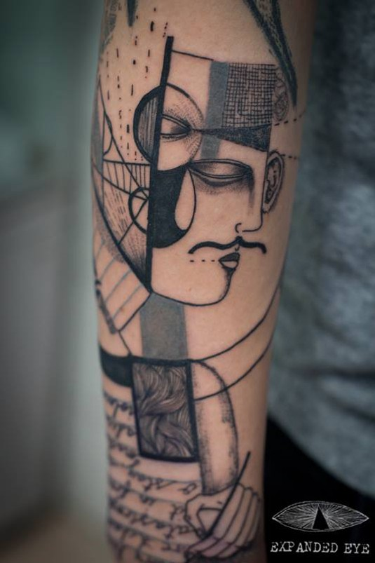 Sketch style black ink tattoo of mans face