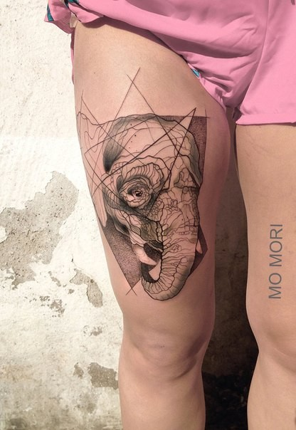 Sketch style black ink thigh tattoo of elephant head