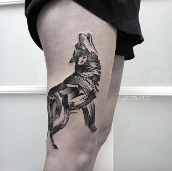 Sketch style black ink thigh tattoo of typical wolf