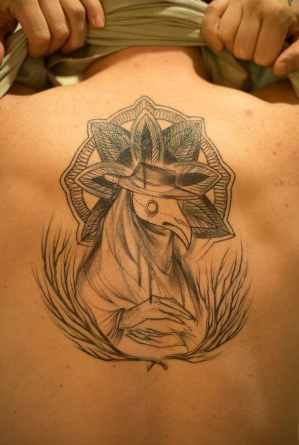Sketch style black ink upper back tattoo of plague doctor with interesting ornaments