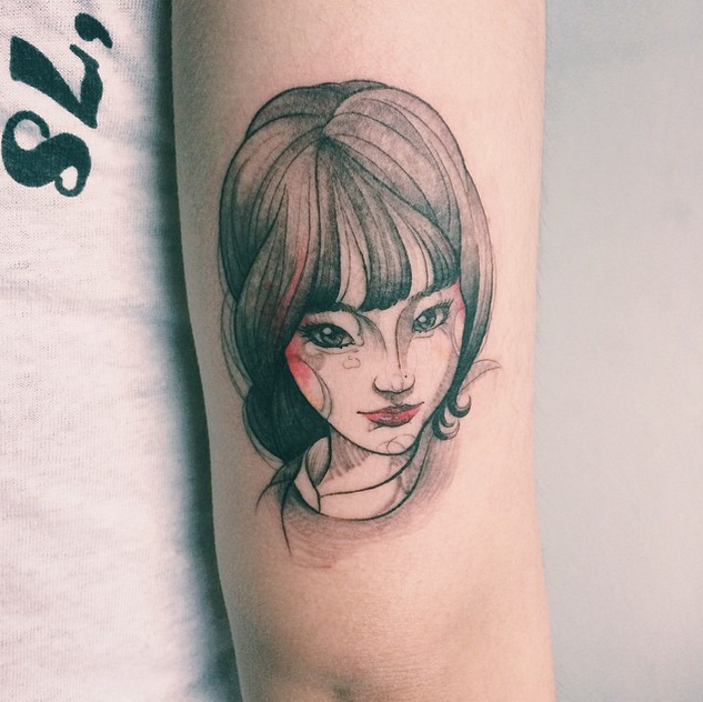 Sketch style colored arm tattoo of beautiful woman face