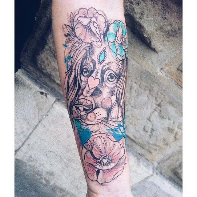 Sketch style colored forearm tattoo of cute dog with flowers and pink heart