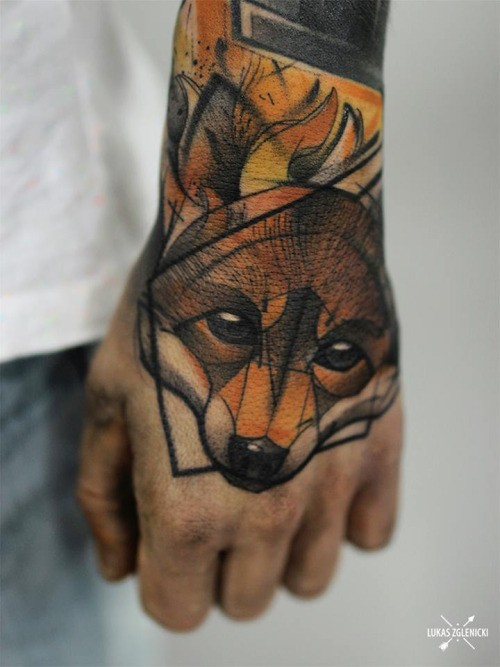 Sketch style colored hand tattoo of small fox head
