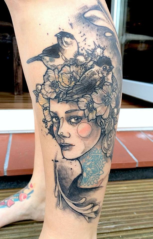 Sketch style colored leg tattoo of woman face with birds and flowers