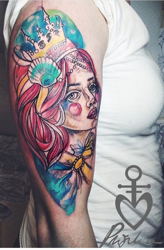 Sketch style colored shoulder tattoo of princess face with crown
