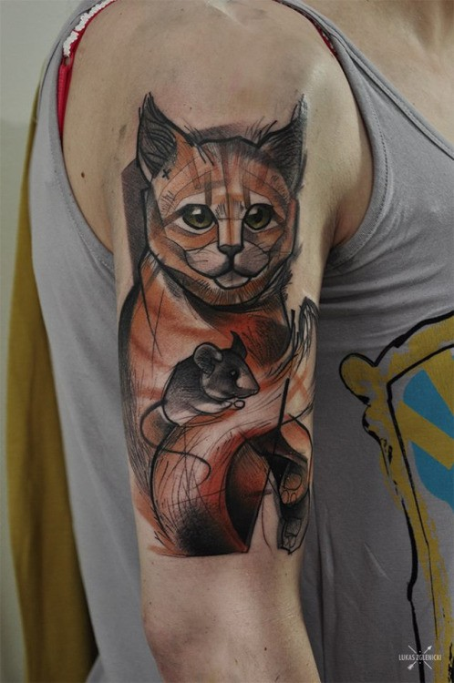 Sketch style colored shoulder tattoo of little cat with mouse