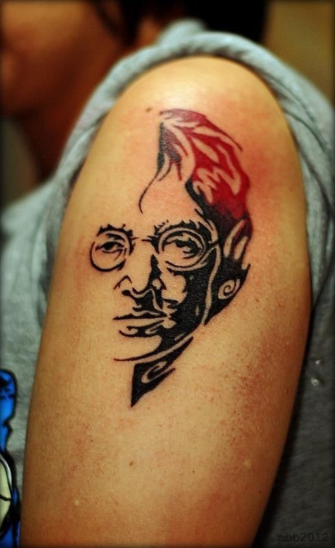 Sketch style colored shoulder tattoo of Lennon face