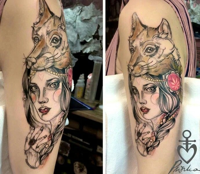 Sketch style colored shoulder tattoo of tribal woman with wolf helmet