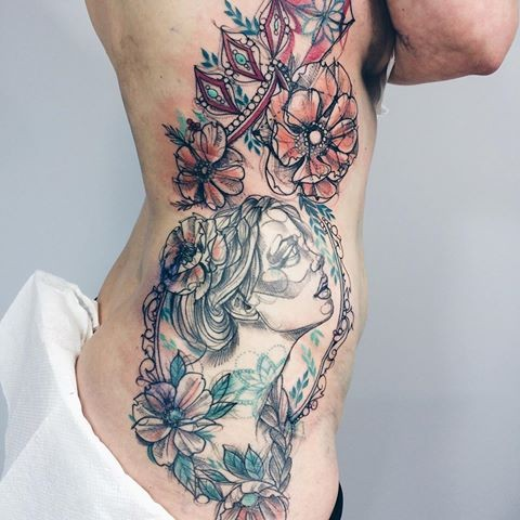 Sketch style colored side tattoo of cute woman with flowers