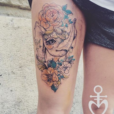 Sketch style colored thigh tattoo of elephant with flowers
