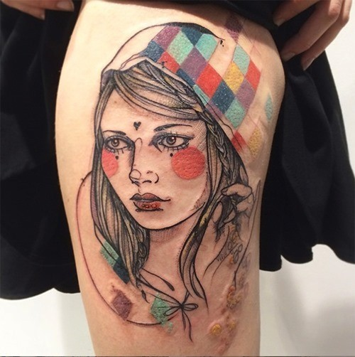 Sketch style colored thigh tattoo of awesome woman