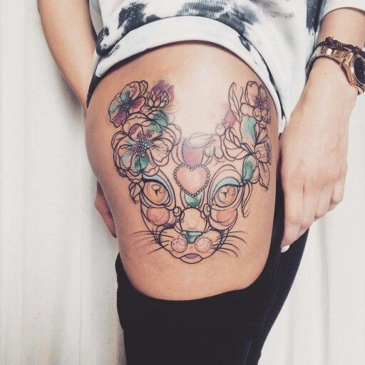 Sketch style colored thigh tattoo of cat head with flowers