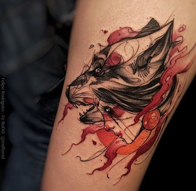 Sketch style colored thigh tattoo of tribal woman with wolf head