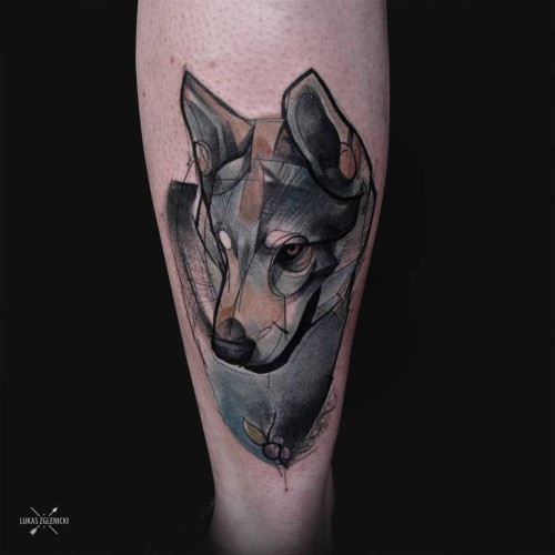 Sketch style colored thigh tattoo of very detailed wolf