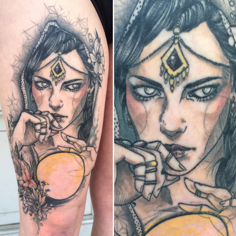 Sketch style colored thigh tattoo of woman face with flowers