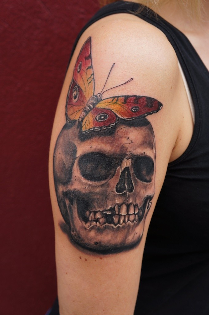 Skull with butterfly tattoo by graynd