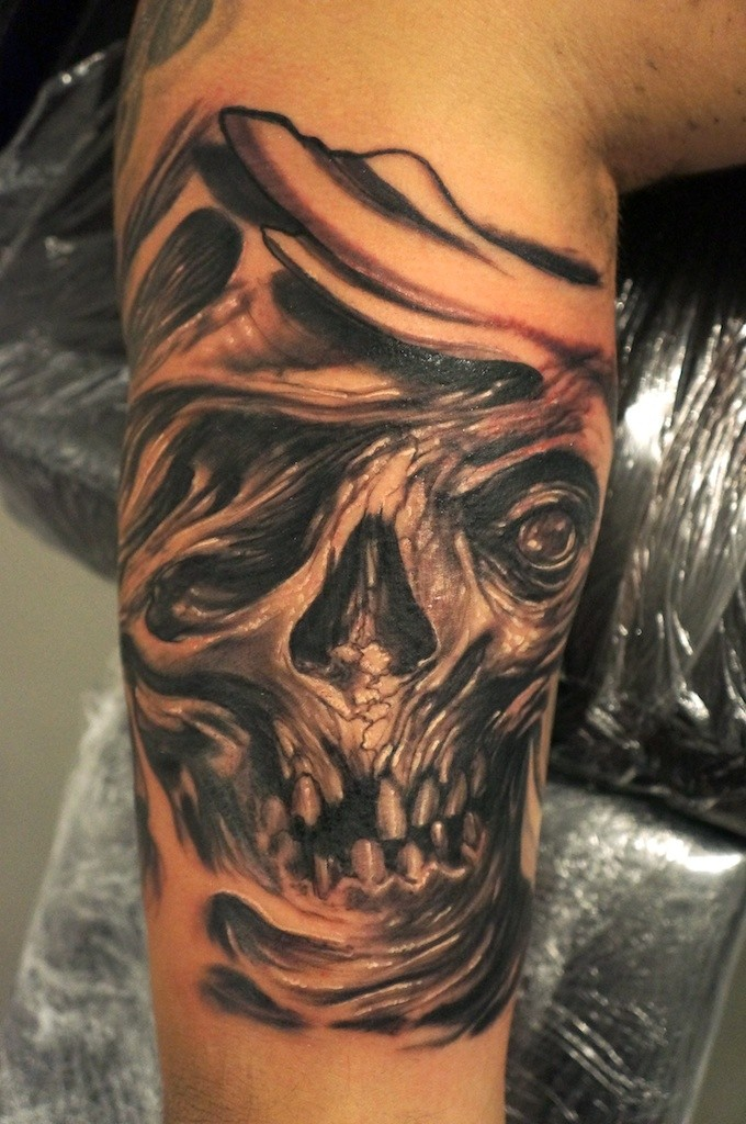 Monster skull in agony tattoo by graynd