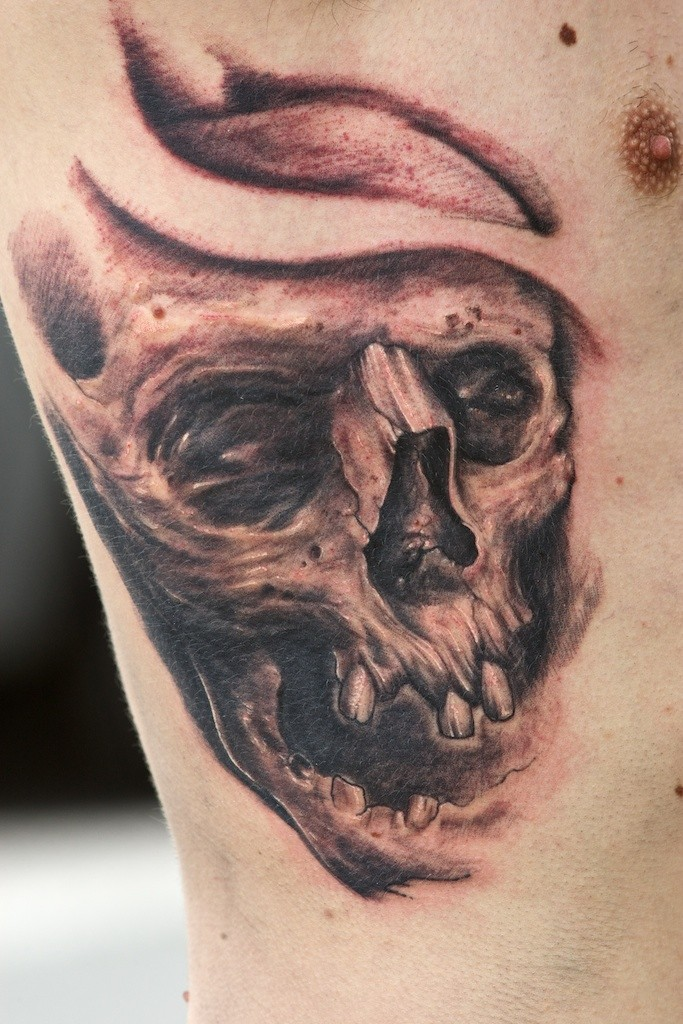 Old skull tattoo on chest by graynd