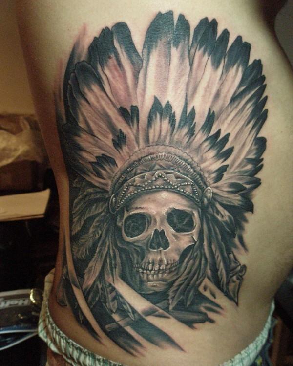 Skull in an indian headdress tattoo on ribs