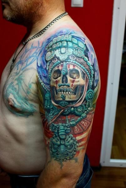 Skull in turquoise jewelry aztec culture of prehispanic period tattoo on shoulder