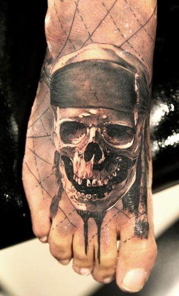 Skull pirate in bandana tattoo on foot