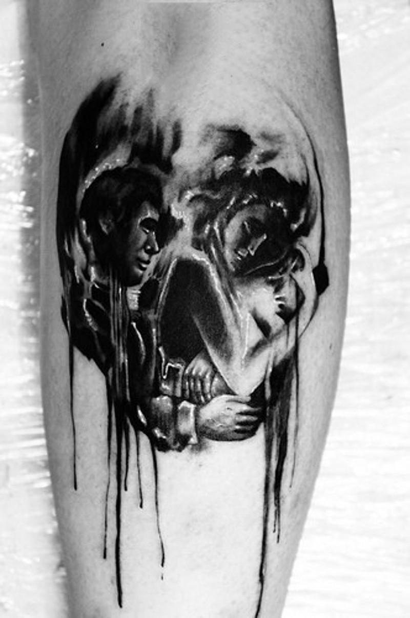 Skull shaped black and white sleeping couple tattoo on leg