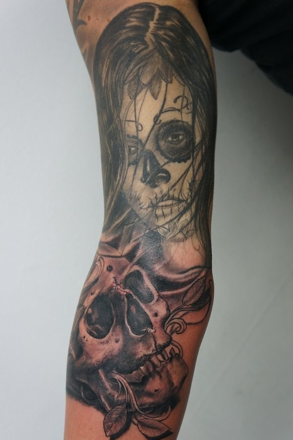 Skull and lady tattoo on arm by graynd