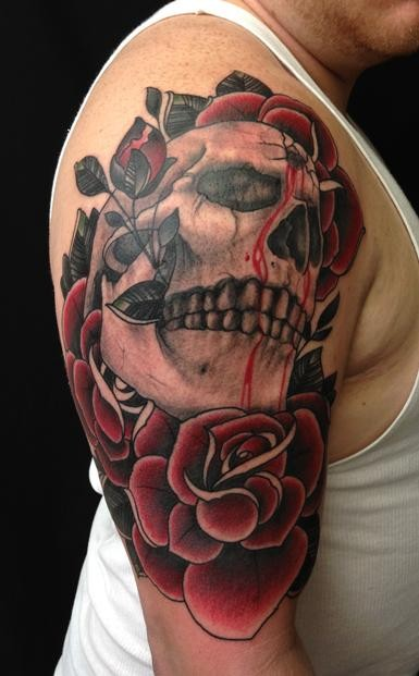 Skull with a bullet hole in forehead and red roses tattoo