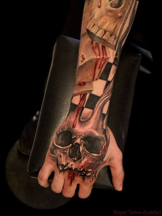 Skull with blood tattoo on hand by Daniel Melaniuk