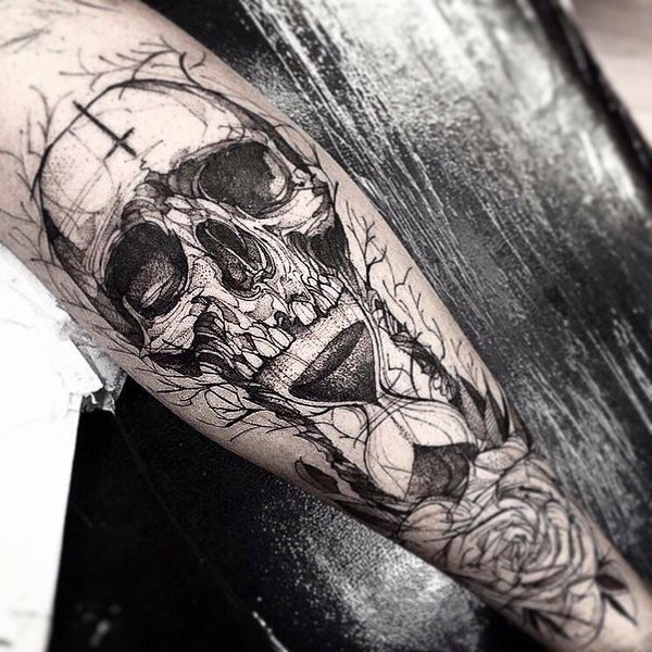 Skull with inverted cross on forehead, hourglass and flower tattoo in engraving style