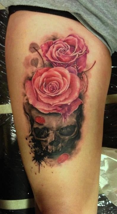 Skull with pink realistic roses tattoo on leg
