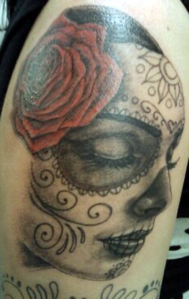 Sleeping day of the dead girl with red rose tattoo