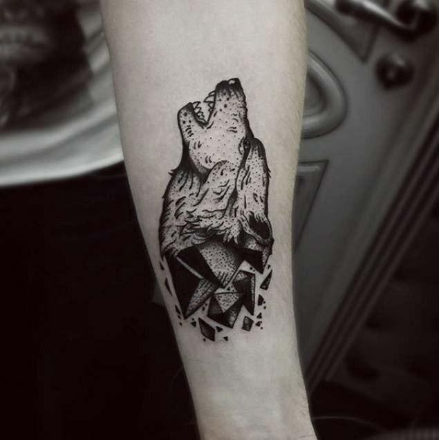 Slim vintage black ink forearm tattoo of corrupting wolf