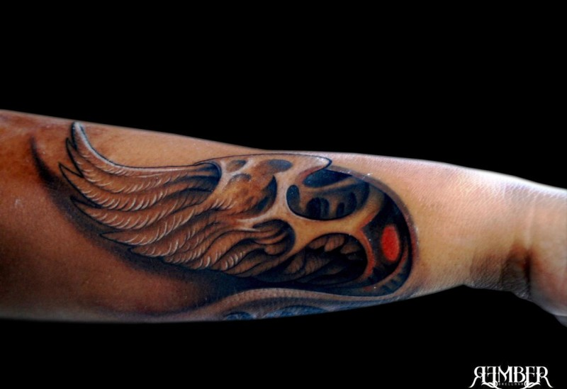 Small 3D style colored arm tattoo of angel wing