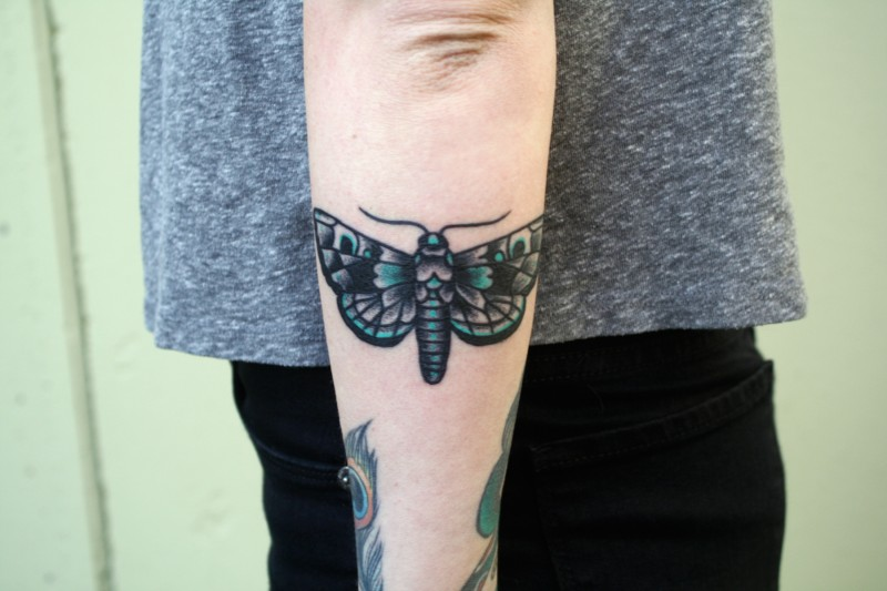 Small beautiful looking arm tattoo of cute butterfly