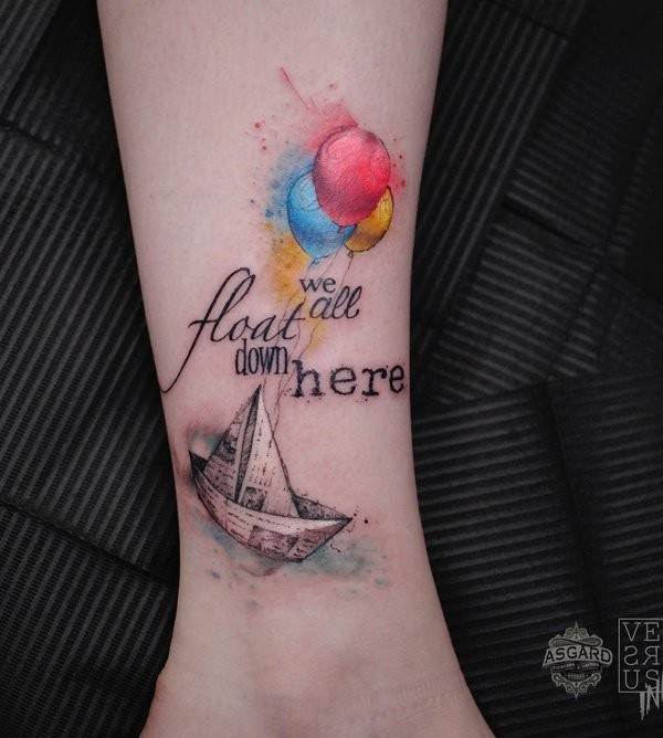Small beautiful looking leg tattoo of paper ship with lettering and balloons