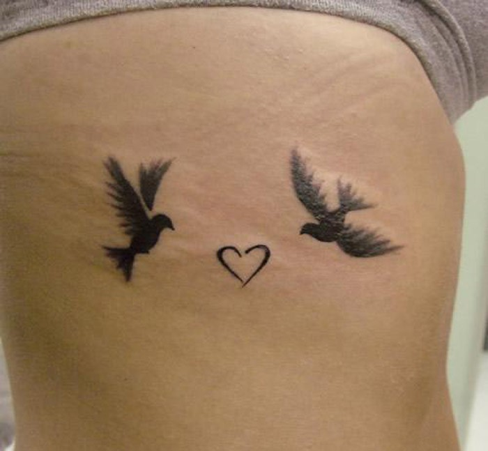 Small bird tattoos with heart shape for women
