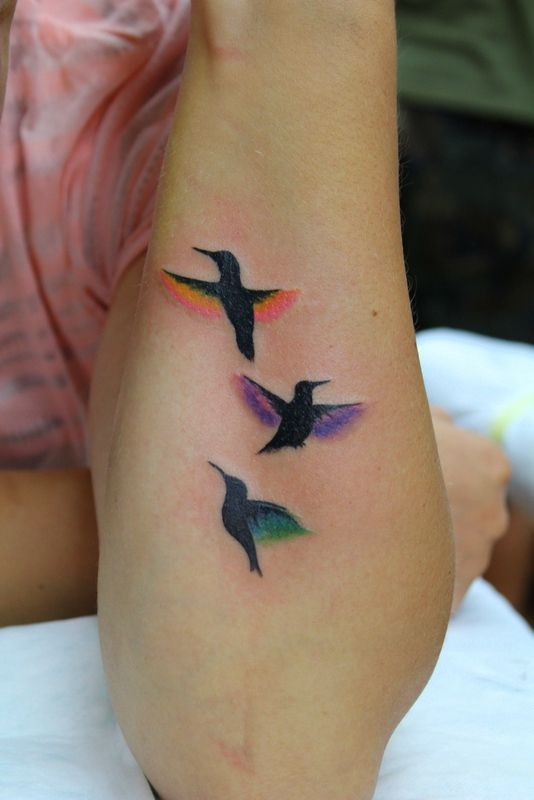 Small birds tattoos with different colour wings