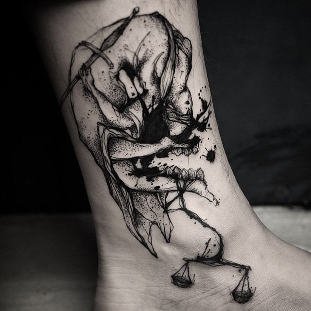 Small black ink ankle tattoo of bloody Justice