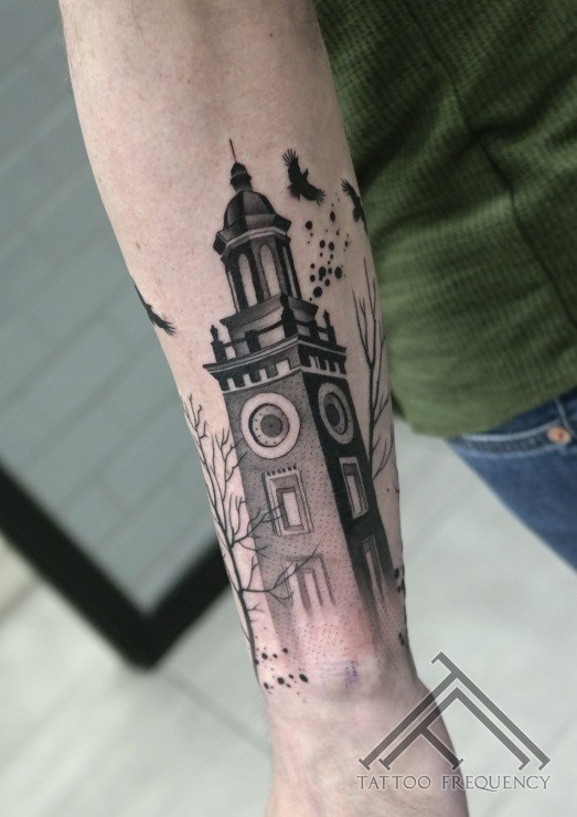 Small black ink arm tattoo of big old tower