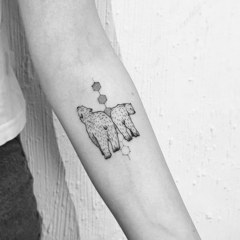 Small black ink forearm tattoo of bear couple
