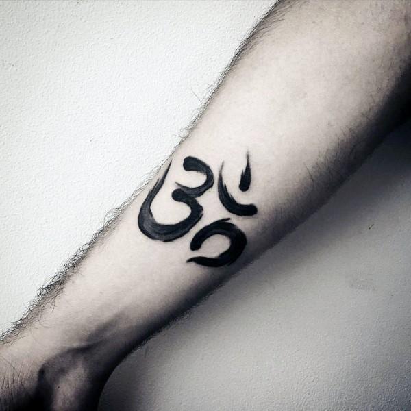 Small black ink forearm tattoo of Hinduism symbol - Tattooimages.biz