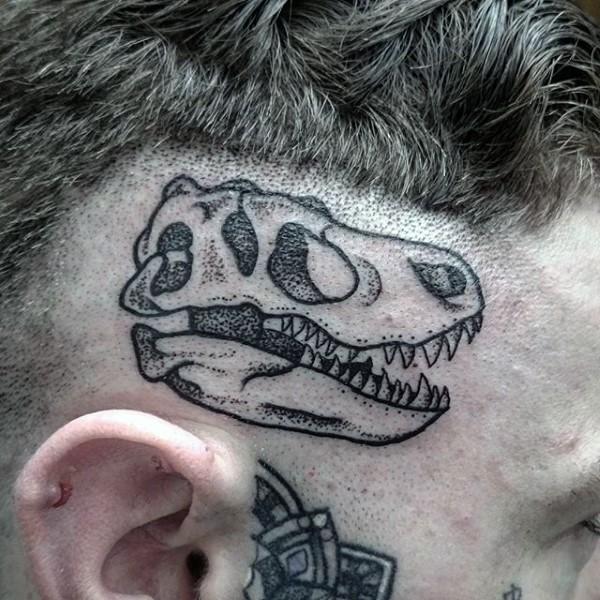 Small black ink funny looking dinosaur skull tattoo on head