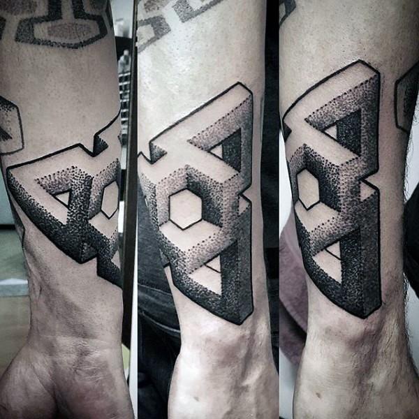 Small black ink geometrical ornament tattoo on arm