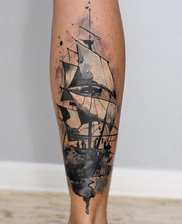 Small black ink illustrative style leg tattoo of sailing ship