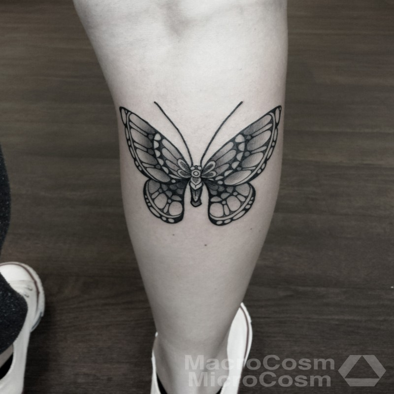 Small black ink leg tattoo of beautiful butterfly